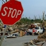 Stop sign in a disaster area.