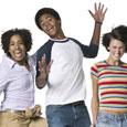 Photograph of three teens jumping for joy.