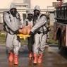 Individuals in hazmat suits.