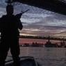 Armed man protecting bridges.