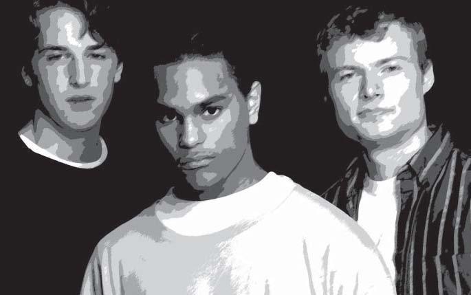 three young men looking at the camera.