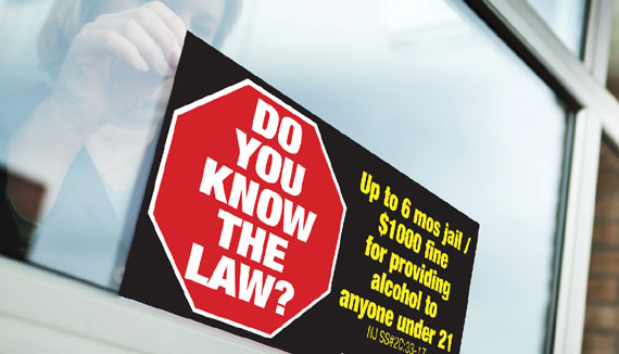 Photo of an advertisement posted in a liquor store window as part of the 'Know the Law' campaign.