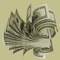 Close up of a roll of hundred-dollar bills.
