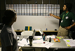 A young man and woman study a whiteboard together. Photograph courtesy of Corporation for National and Community Service.