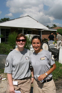 Two young women from Americorps pose at a work site in post-Katrinia Saint Bernard Parish, Louisiana.  Photograph courtesy of Corporation for National and Community Service.