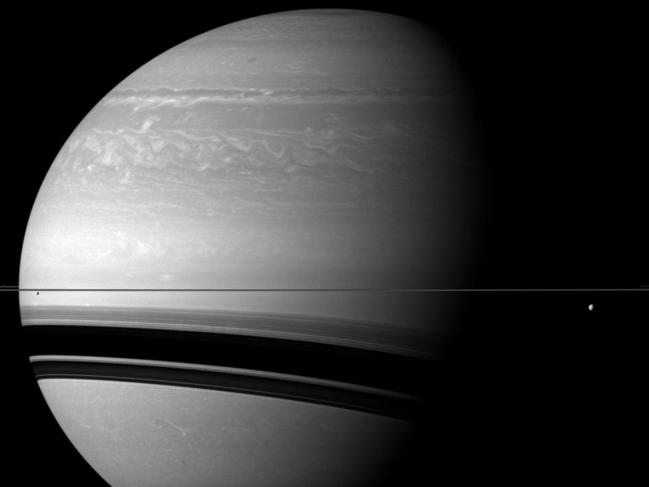 Saturn with moon Tethys and Enceladus