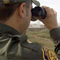 Border security agent with binoculars
