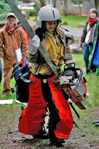 Image description: A sixth grader is tested to see if she has what it takes to be a forest firefighter in a United States Forest Service class for school kids in Oregon. Photo from the U.S. Department of Agriculture.