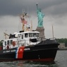 Coast Guard boat and the Statue of Liberty