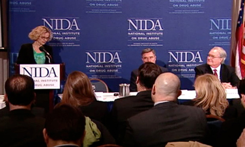 Image of NIDA Director Nora D. Volkow, M.D. discussing the 2010 Monitoring the Future survey results at press conference.