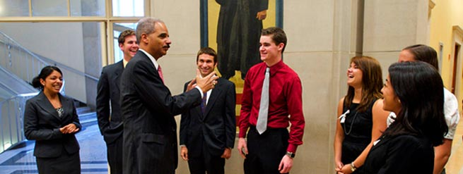 Photo of Attorney General Eric Holder and Interns