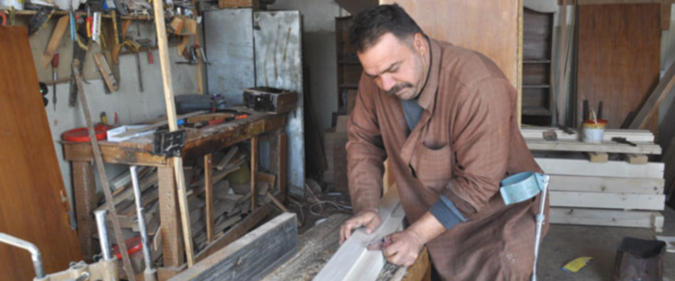 man at work in his shop in Iraq