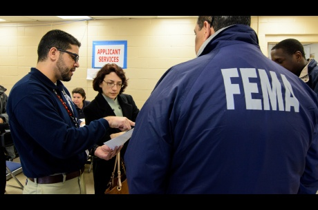 Officials visit a Disaster Recovery Center in Ft. Tilden