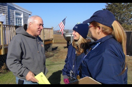 Homeowner Mike Gallagher, (L), receives information from FEMA Community Relations Specialists Angela Lynn, (C), and Maribel Rovira, (R). FEMA is working with state and local officials to assist residents who were affected by Hurricane Sandy. Location: