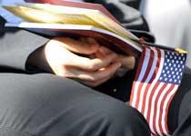 New citizen holding a U.S. flag