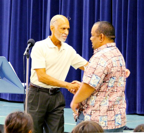RMI Ambassador to the U.S., Charles Paul, right, shakes the hand of his former senior government teacher, Ric Fullerton, who still teaches at Kwajalein High School.