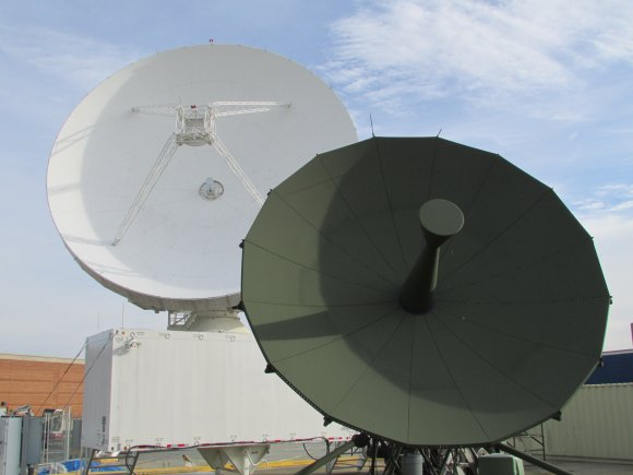 Two terminal dishes assist Army space Soldiers of Alpha Company, 53rd Signal Battalion (SATCON) at the Wideband Satellite Communications Operations Center, Fort Detrick, Md. The green antenna is called a replacement terminal and is temporarily supporting A Company's Auxiliary Site Control Terminal mission, while the Modernized Enterprise Terminal (white antenna) is going through testing in preparation to fill a Wideband Global Satellite and ASCT role. The MET is the latest antenna to be fielded with several upgraded capabilities. This facility provides Alpha Company controllers increased capabilities to control the communications payloads and communications transmissions of the Defense Satellite Communication System and WGS constellations.