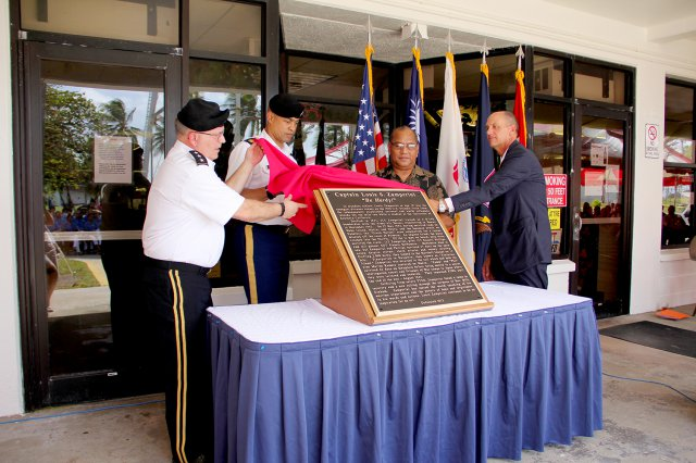 From left, Lt. Gen. Richard Formica, SMDC commanding general; Command Sgt. Maj. Larry Turner, SMDC command sergeant major; RMI President Christopher Loeak; and Ambassador Thomas Armbruster unveil the new plaque that will hang inside the Captain Louis S. Zamperini Dining Facility. The dining hall was rededicated Jan. 16.