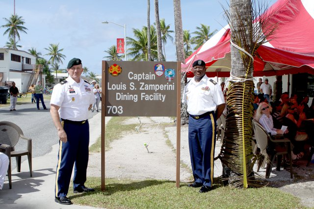 U.S. Army Kwajalein Atoll Commander Col. Shannon Boehm, left, and Sgt. Maj. Roderick Prioleau unveil the new sign for the rededicated dining hall on Kwajalein.