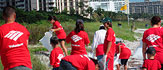 Photograph of people cleaning up a park, wearing Bank of America t-shirts.