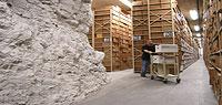A staffer wheels a cart through the stacks of the Lenexa Federal Records Center