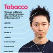 Photo of a young man diagramming the effects of tobacco on the body.