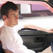 Teen boy in his car