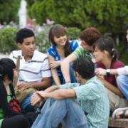 group of teens sitting around