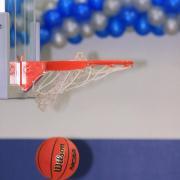 Basketball going through basketball hoop.