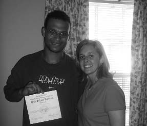 A proud GED graduate at Haven House services in Raleigh, North Carolina.