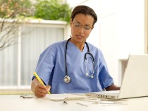 Health care provider working on laptop