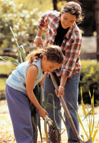 Woman and child working in a garden.