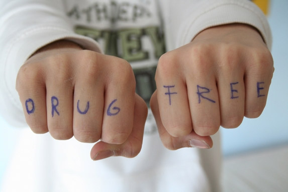 "Two hands with the words ""DRUG FREE"" written on the knuckles."