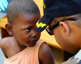CDR Denis is preparing this little boy for the vaccinations he is about to administer