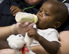 Haitian child being bottle fed
