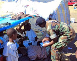 Lieutenant Commander Jean Paul gathering intelligence in a tent.