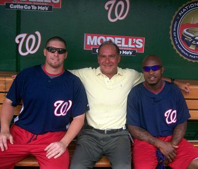 Brian Marquis and pitcher Garrett Mock (L) and center fielder Willie Harris (R)