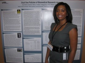 2010 intern Dionne Barner standing in front a research project poster