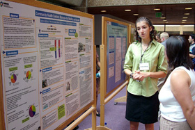 Intern Northup standing in front of her poster during the Summers of Discovery Poster Session
