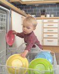 Picture of a kid loading a dishwasher