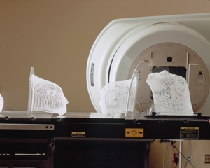 Lattice face masks sitting on patient bed prior to radiation therapy