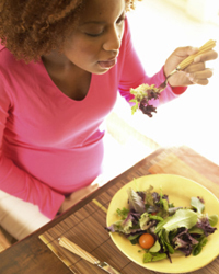 Photo: A woman eating a healthy salad.