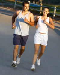 Photo: A man and woman jogging.