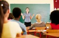 A teacher talks to her class
