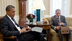 President Obama looking at his IPad.
