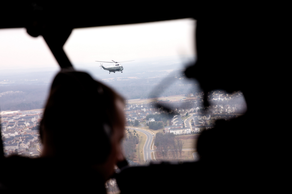 <p>Marine One is seen in flight from Nighthawk Two, as President Barack Obama travels from the White House to Leesburg, Va., Feb. 7, 2013. (Official White House Photo by Pete Souza)<br /> <br /> This official White House photograph is being made available only for publication by news organizations and/or for personal use printing by the subject(s) of the photograph. The photograph may not be manipulated in any way and may not be used in commercial or political materials, advertisements, emails, products, promotions that in any way suggests approval or endorsement of the President, the First Family, or the White House.</p>