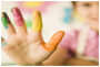 Child's hand with fingerpaint