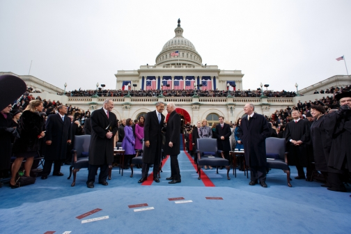 President Barack Obama talks with Vice President Joe Biden during the inaugural swearing-in ceremony