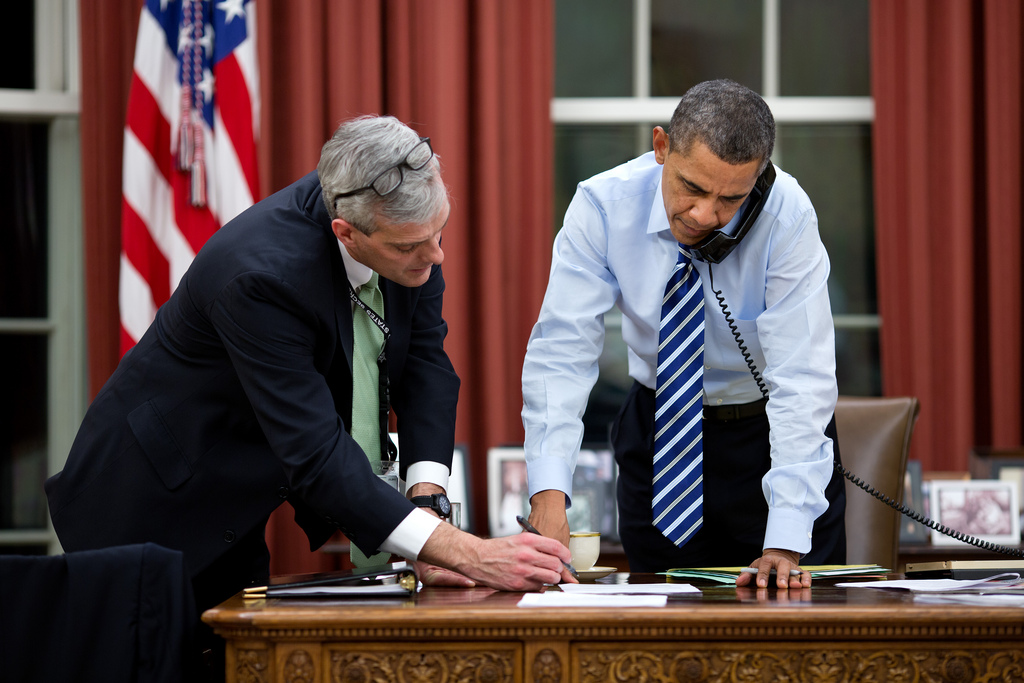 <p>President Barack Obama confers with Chief of Staff Denis McDonough as he talks on the phone in the Oval Office, Feb. 6, 2013. (Official White House Photo by Pete Souza)<br /> <br /> This official White House photograph is being made available only for publication by news organizations and/or for personal use printing by the subject(s) of the photograph. The photograph may not be manipulated in any way and may not be used in commercial or political materials, advertisements, emails, products, promotions that in any way suggests approval or endorsement of the President, the First Family, or the White House.</p>