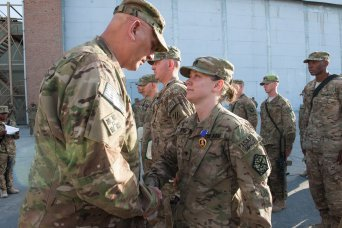 Odierno presents Purple Heart to Soldier in Afghan